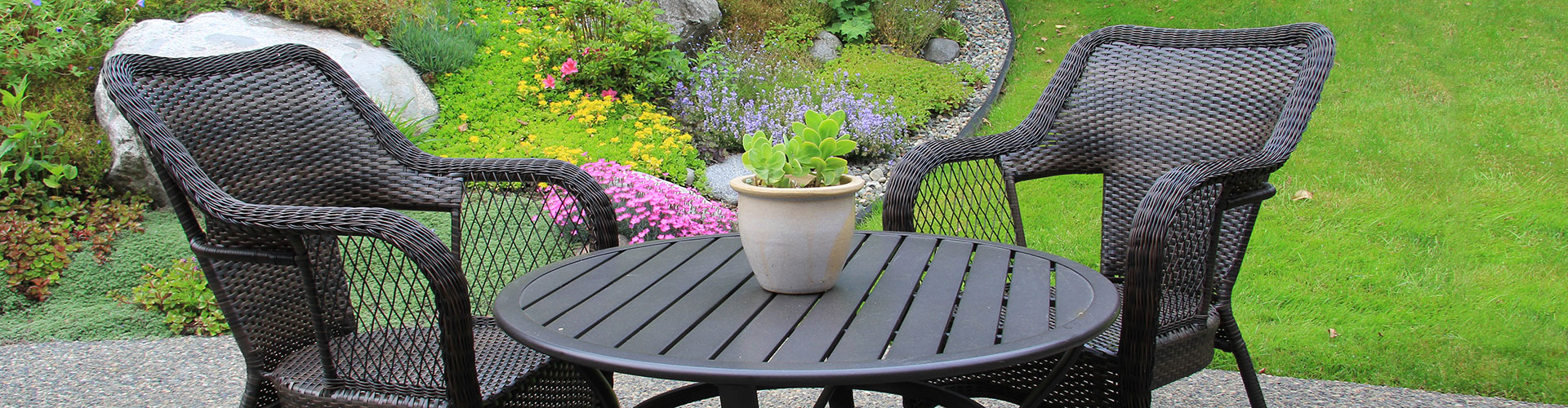 backyard flagstone patio with garden furniture